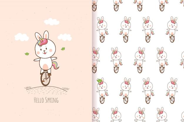 Nettes kaninchen-einhorn, das eine fahrrad-ostertag-karikaturhand gezeichnet reitet