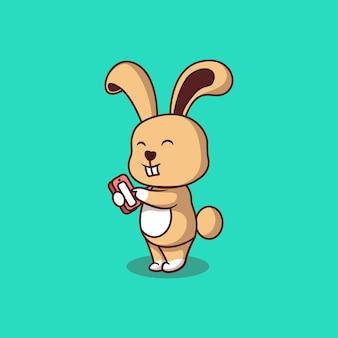 Nettes kaninchen mit handphone cartoonillustration