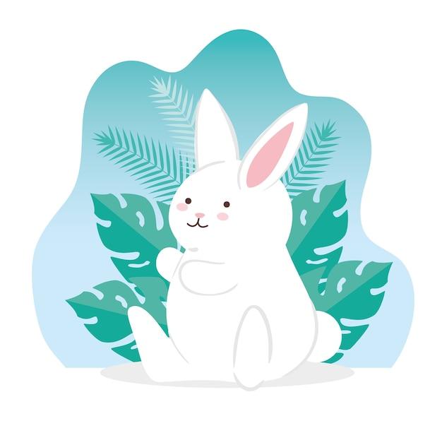 Nettes kaninchen mit tropischen blättern