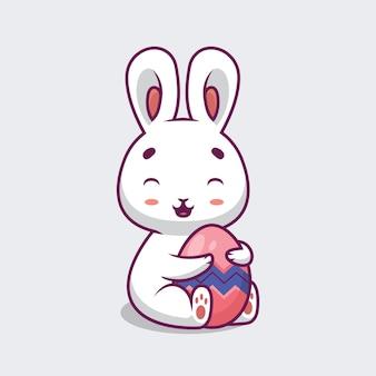 Nettes kaninchen umarmt osterei-karikaturillustration