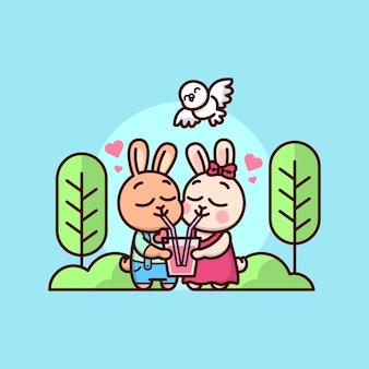 Nettes kaninchenpaar mit einem getränk im freien. fröhlichen valentinstag