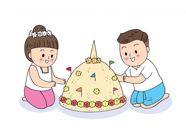 Nettes karikatur songkran festival thailand. jungen und mädchen, die einen pagodentempel mit sand bauen