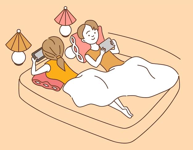 Nettes karikaturpaar mit geräten im bett