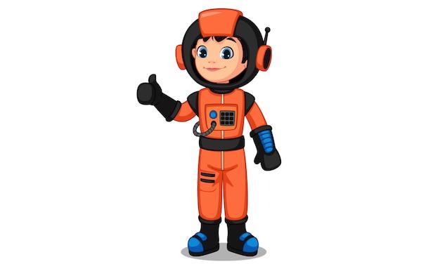 Nettes kleines astronautenkind, das daumen zeigt