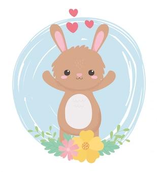 Nettes kleines kaninchen blüht herzen reizende karikaturtiere in einer natürlichen landschaft