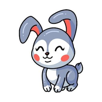 Nettes kleines kaninchenkarikatursitzen