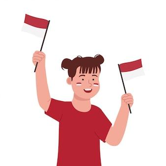 Nettes kleines mädchen, das indonesien-flagge hält, feiern unabhängigkeitstag