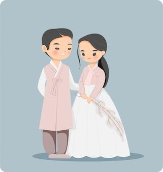 Nettes koreanisches paar in der traditionellen hanbok-kleidkarikaturfigur