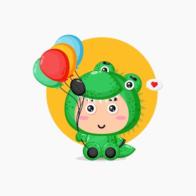 Nettes krokodilmaskottchen, das luftballons trägt