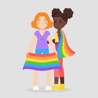Nettes lesbisches paar mit abgebildeter lgbt flagge