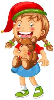 Nettes mädchen, das weihnachtsmütze trägt und teddybär auf weiß hält