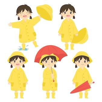 Nettes mädchen im gelben regenmantel und im roten regenschirmvektorsatz