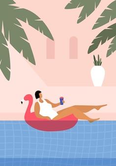 Nettes mädchen in einem weißen badeanzug schwimmt auf einem aufblasbaren flamingo.