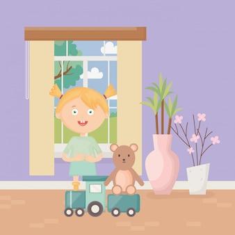 Nettes mädchen mit zug und teddybär im haus, kinderspielwaren