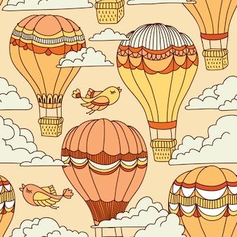 Nettes nahtloses muster mit heißluftballonen, vögeln und wolken