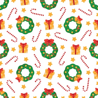 Nettes nahtloses muster mit weihnachtskränzen und präsentkartons.