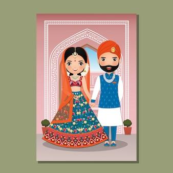 Nettes paar der braut und des bräutigams in der traditionellen indischen kleiderkarikatur.