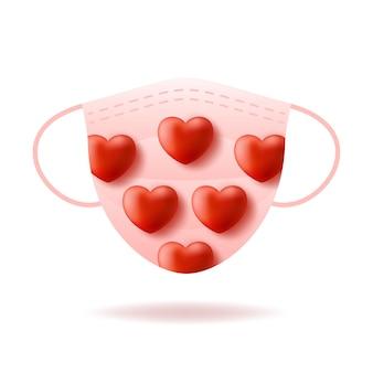 Nettes realistisches rotes herz auf rosa medizinischer maske