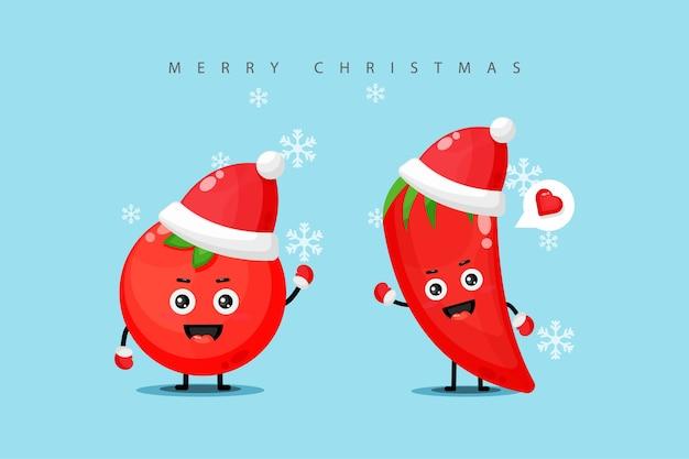 Nettes tomaten- und rotes chili-maskottchen, das weihnachtskostüm trägt