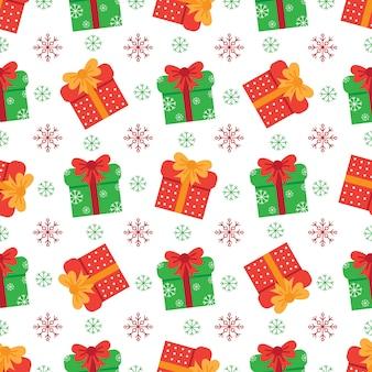 Nettes weihnachtsnahtloses muster mit präsentkartons.