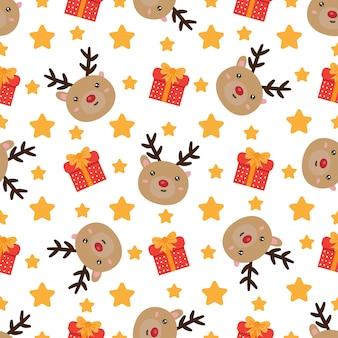 Nettes weihnachtsnahtloses muster mit ren und präsentkartons.