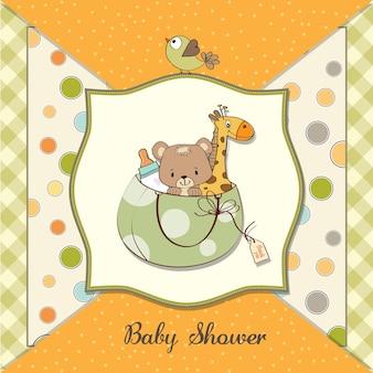 Neue babymitteilungskarte mit tasche und gleichen spielwaren