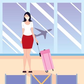Neue normale junge frau des flughafens mit schutzmaske und taschenwarteflugzeug