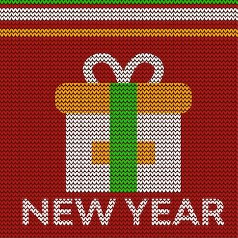 Neues jahr mit geschenkbox-zeichenentwurf im textilstrickstoff