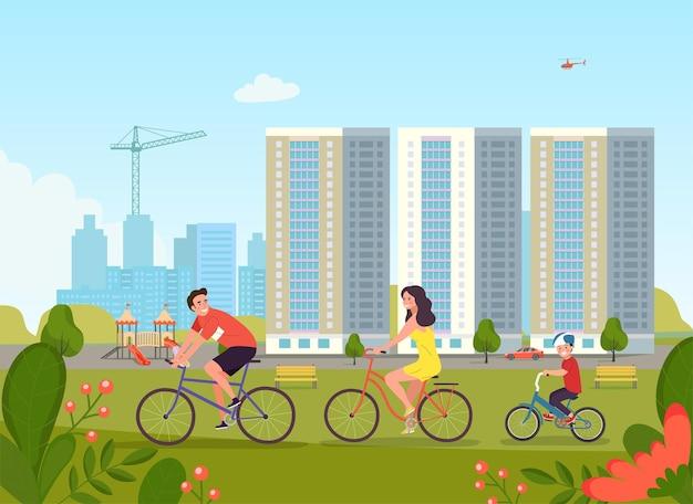 Neues mehrfamilienhaus und kinderspielplatz im wohngebiet. familie, die fahrrad fährt.