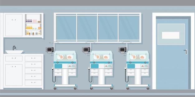 Neugeborenes baby der kinderbetreuung innerhalb der säuglingsinkubatoren im krankenhaus.