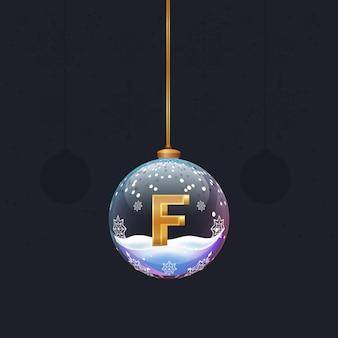 Neujahrsalphabetbuchstabe im glasweihnachtsspielzeug goldener 3d-buchstabe f im dekorationselement