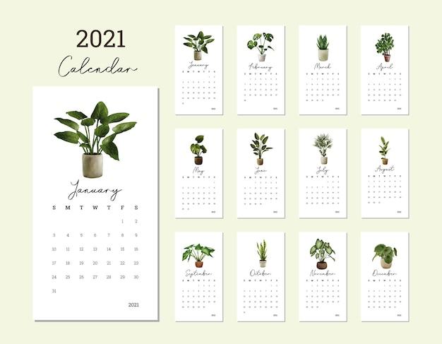 Neujahrskalender 2021 mit gezeichneter illustration der pflanzenhand