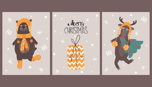 Neujahrskarten mit niedlichen tieren. postkarte mit einem hirsch und einem bären.