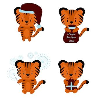 Neujahrsset 2022 mit verschiedenen tigerbabys. mit einer tüte geschenke, mit einer weihnachtsmütze, mit einer geschenkbox, mit einer wunderkerze