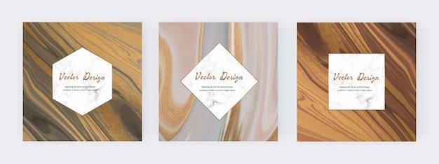 Neutrale flüssige tinte mit goldenen glitzer-textur-bannern und marmorrahmen Premium Vektoren