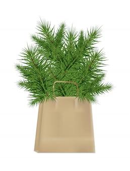 Niederlassungen des weihnachtsbaums im kraftpapierpaket lokalisiert auf einem weißen hintergrund