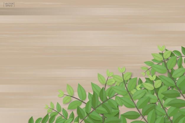 Niederlassungen von grünen blättern auf brauner hölzerner beschaffenheit.