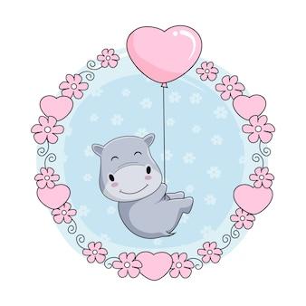 Niedliche baby-flusspferd-cartoon-fliege mit liebes-ballon