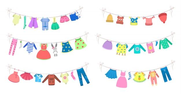 Niedliche babykleidung, die am seil trocknet. kleidung an der wäscheleine. kleid und kostüm, höschen und shorts. illustration