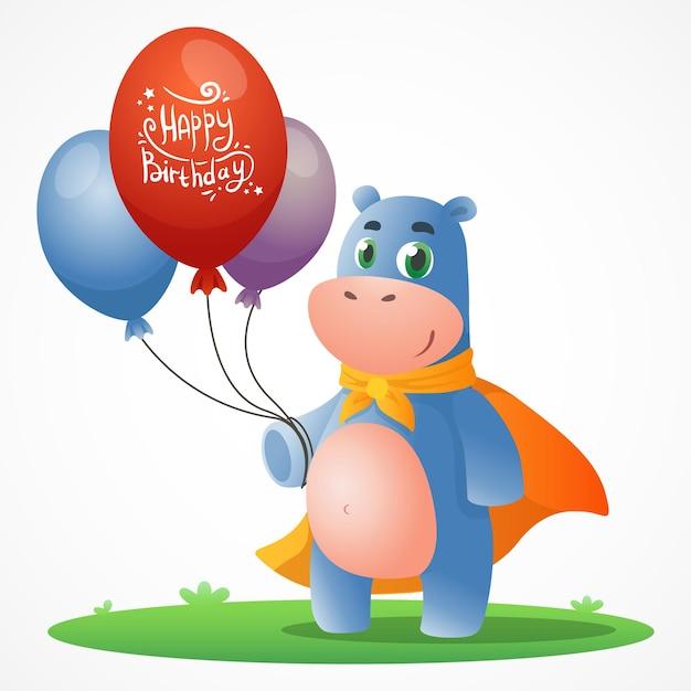 Niedliche cartoon-postkarte mit nilpferd im heroischen orangefarbenen umhang, der auf gras steht und luftballons hält