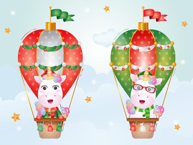 Niedliche einhorn-weihnachtsfiguren auf heißluftballon mit einer weihnachtsmütze, einer jacke und einem schal