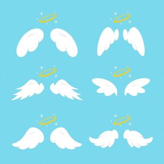 Niedliche engelsflügel mit heiligenschein. vektor cartoon flache clipart set isoliert