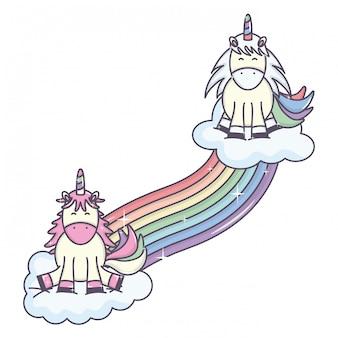 Niedliche entzückende einhörner mit wolken und regenbogen