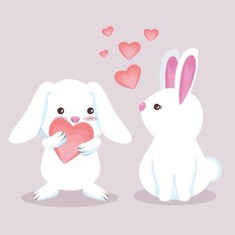 Niedliche kaninchenpaare mit entzückenden herzen
