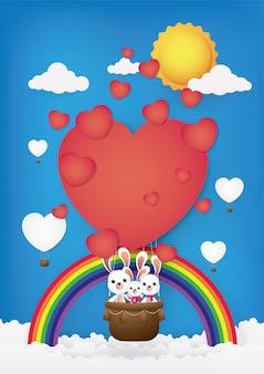 Niedliche karikatur, kaninchen auf dem heißluftballon.