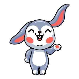 Niedliche kleine kaninchenkarikatur präsentiert