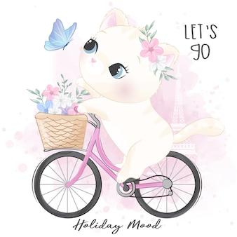 Niedliche kleine miezekatze, die fahrrad fährt