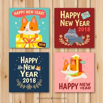 Niedliche neujahrskarten mit katzen und hunden