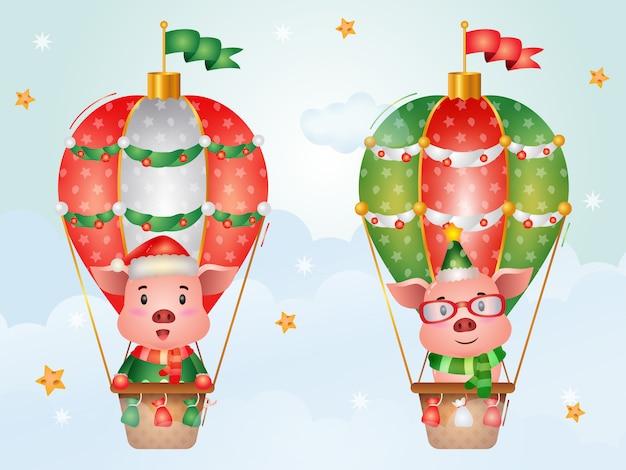 Niedliche schweinweihnachtsfiguren auf heißluftballon mit einer weihnachtsmütze, einer jacke und einem schal