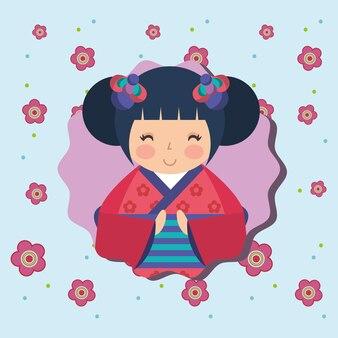 Niedliche traditionelle japanische kokeshi puppe in den kimonoblumen